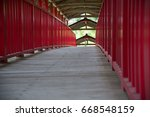 Historical red bridge at Hokoji Zen temple.