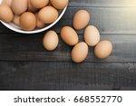 fresh hen egg in white bowl and ... | Shutterstock . vector #668552770