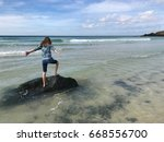 girl accepting the oceans... | Shutterstock . vector #668556700