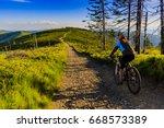 mountain biking women riding on ... | Shutterstock . vector #668573389