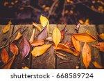 scraps of falling leaves on... | Shutterstock . vector #668589724