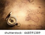 retro compass with vintage map | Shutterstock . vector #668591389