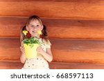 the girl is going to a flower | Shutterstock . vector #668597113