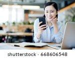 business women work in front of ...   Shutterstock . vector #668606548