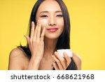 asian  woman on yellow... | Shutterstock . vector #668621968