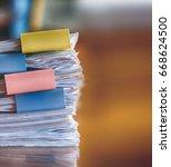 stack of paperwork on working...   Shutterstock . vector #668624500