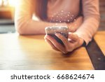 woman hand holding mobile phone ... | Shutterstock . vector #668624674