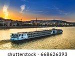 tour boat on sunset on danube... | Shutterstock . vector #668626393
