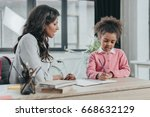 mother helping little daughter... | Shutterstock . vector #668632129