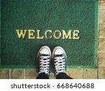 sneakers with doormat   Shutterstock . vector #668640688