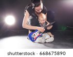 mom teaches young son play... | Shutterstock . vector #668675890