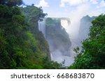 victoria waterfall in zimbabwe... | Shutterstock . vector #668683870