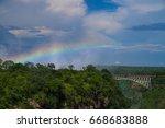 africa landscape rainbow over... | Shutterstock . vector #668683888