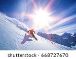 Full Length Of Skier Skiing On...