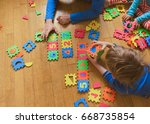 teacher and kids playing with... | Shutterstock . vector #668735854