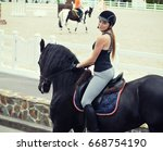 young woman in equestrian...   Shutterstock . vector #668754190