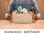 volunteer with donation box... | Shutterstock . vector #668756620