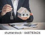 real estate agent handing over... | Shutterstock . vector #668783626