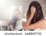 young woman looking herself... | Shutterstock . vector #668809750
