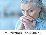 Beautiful Sad Elderly Woman...