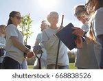 volunteering  charity  people...   Shutterstock . vector #668838526