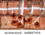 wall with bullet damage. no... | Shutterstock . vector #668847454
