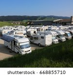Small photo of Asiago, VI, Italy - May 27, 2017: motorhome and caravan in the wide parking after the cycling race called Giro di Italia