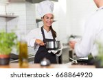 female chef in kitchen  | Shutterstock . vector #668864920