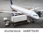 airplane at gate during... | Shutterstock . vector #668875630