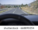 driving slowly behind cyclists... | Shutterstock . vector #668890354