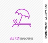 umbrella and sun lounger on the ... | Shutterstock .eps vector #668896720
