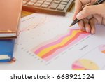 businessman check profit... | Shutterstock . vector #668921524