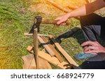 a man chops firewood on a hike | Shutterstock . vector #668924779