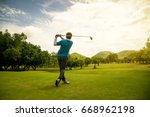 back of asian golfer swing golf ... | Shutterstock . vector #668962198