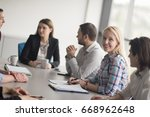 business team meeting in modern ... | Shutterstock . vector #668962648