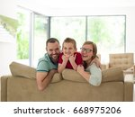 happy young family with little... | Shutterstock . vector #668975206