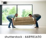 two young men carry the sofa in ... | Shutterstock . vector #668981650