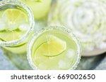 key lime margarita garnished... | Shutterstock . vector #669002650