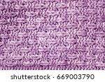 purple color knitted pattern.... | Shutterstock . vector #669003790