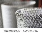 rolls of steel wire mesh | Shutterstock . vector #669021046