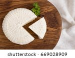 top view on sliced round white... | Shutterstock . vector #669028909