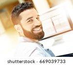 portrait of trendy guy working... | Shutterstock . vector #669039733