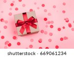 Present Box With Red Bow On...