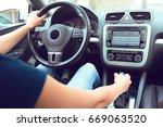 woman driver driving a car | Shutterstock . vector #669063520