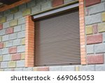 shutter security barrier.... | Shutterstock . vector #669065053
