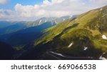 aerial photo of a high alpine... | Shutterstock . vector #669066538