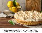 tasty lemon meringue pie on... | Shutterstock . vector #669075046