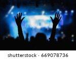 girl enjoying the music... | Shutterstock . vector #669078736