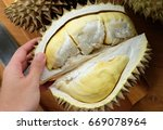 Small photo of Peel a dur-ian with hand ,how to eat a dur-ian ,Open a dur-ian with hand