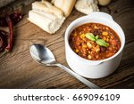 mexican chili con carne in bowl.... | Shutterstock . vector #669096109